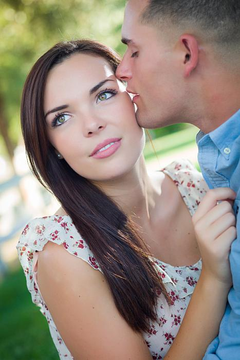 kozzi-mixed race romantic couple portrait in the park-588x883
