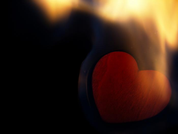 kozzi-14895347-Flaming heart on a black background-1670x1257