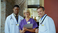 kozzi-Three medical professionals stand together and-961x540