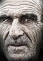 kozzi-3108999-closeup portrait of old man wrinkled elderly skin face-1215x1727