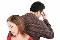 kozzi-young couple standing back to back having relationship difficult-883x588