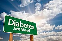 kozzi-5731382-diabetes just ahead green road sign and clouds-883x588